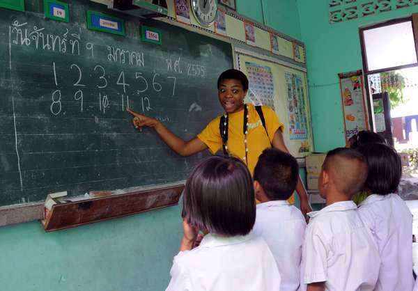 Sailors help teach school kids in Thailand.